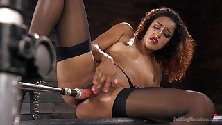Curly haired ebony slutty works the fucking machine like a goddess