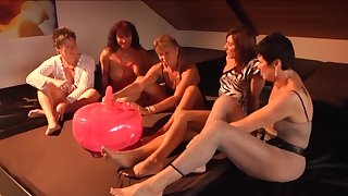 Inflatable ball dildo getting tested by a group of horny mature women
